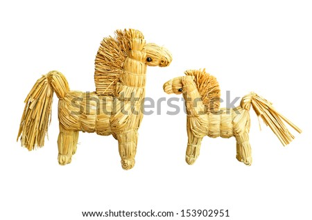 Two figurines of strawy mare and her foal, isolated - stock photo
