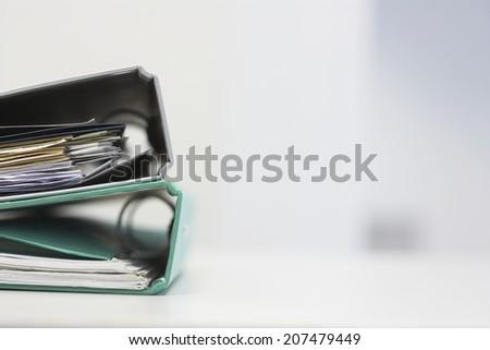 Two file folders on office desk - stock photo