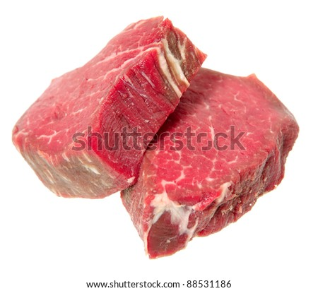 two filet mignon steaks, cut from beef tenderloin, isolated on a white background. - stock photo
