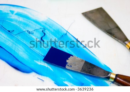 Two Filling knives used to mix the inks of an offset printing process - stock photo