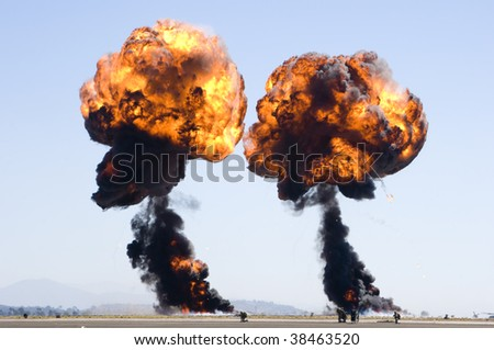 two fireballs from explosions displayed at an airshow - stock photo