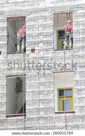 two firefighters during rescue drills in the Firehouse - stock photo