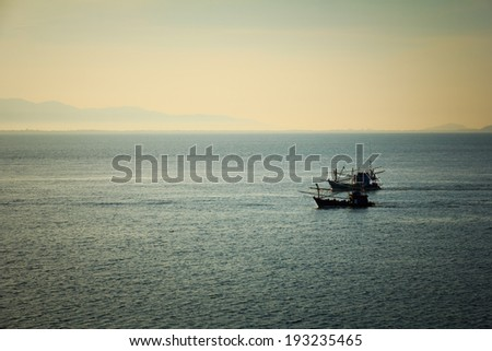 Two fishing boat silhouette