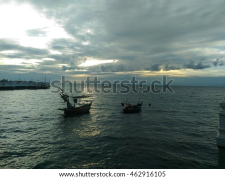 Two fishing boats at sunrise time on the sea