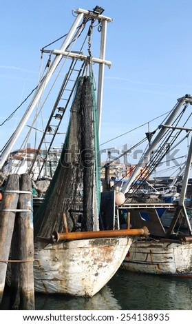 Two Fishing vessels in sea haven moored in Italy - stock photo