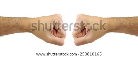Two fists punching each other. Confrontation gesture. Opposite concept - stock photo