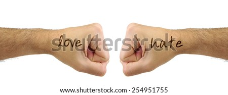 Two fists punching each other with LOVE HATE words. Confrontation gesture. Opposite concept - stock photo