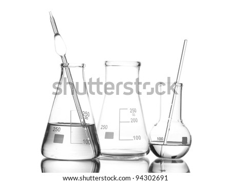 Two flasks with water and one empty flask with reflection isolated on white - stock photo