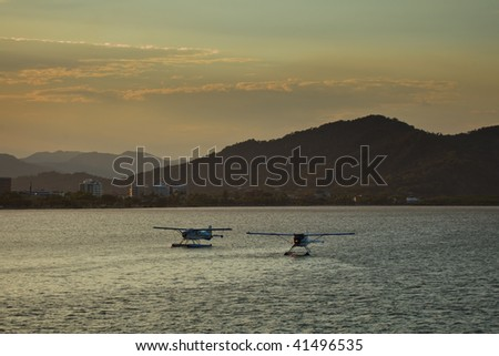 Two Float Planes in Cairns Harbor, Australia - stock photo