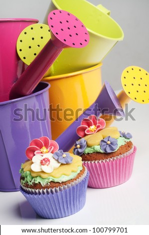 Two floral cucakes in a spring setting - stock photo