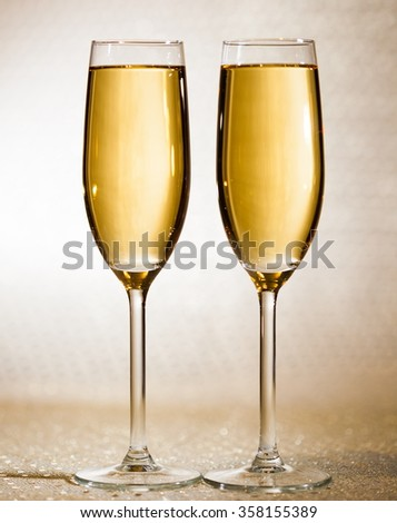 Two flutes glasses white wine. Holiday background. Luxury drink.