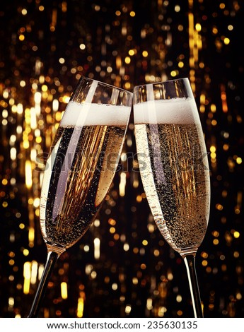 Two flutes of champagne on bokeh background - stock photo