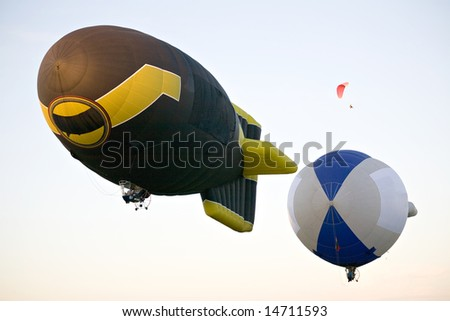 two flying dirigibles - stock photo