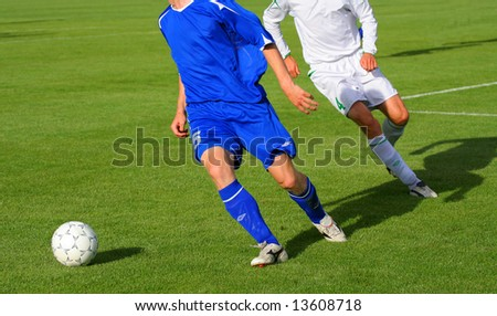 Two football players with the white ball - stock photo