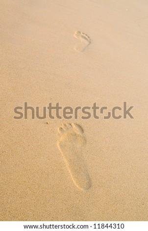 two footprints at Patong beach, Phuket, Thailand - stock photo