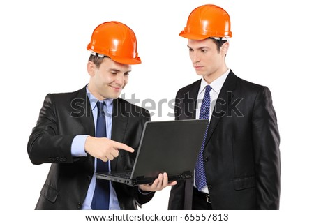 Two foremen looking at laptop isolated on white background - stock photo