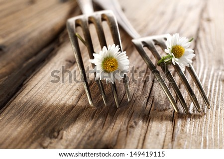 two forks and two flowers  - stock photo