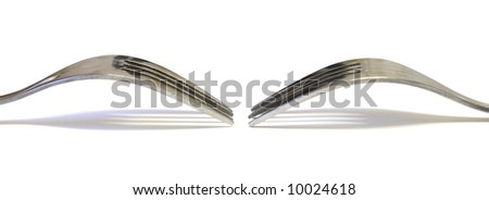Two forks facing each other on a white background. Image could be used as a banner - stock photo