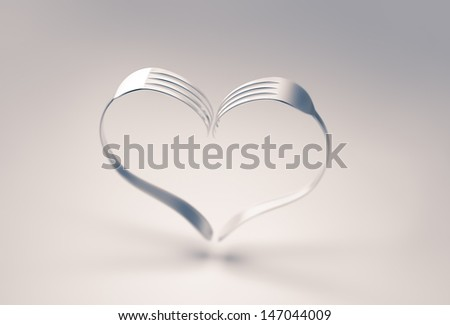 Two forks forming a heart. - stock photo