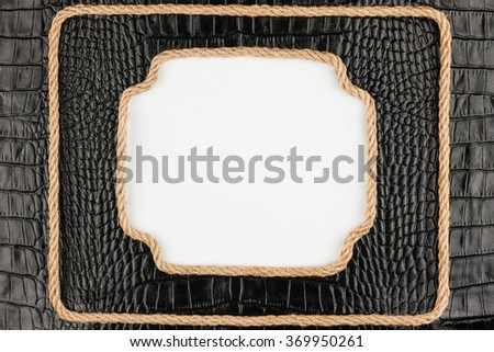 Two frame of rope, lies on a background of a black crocodile skin, with place for your text - stock photo
