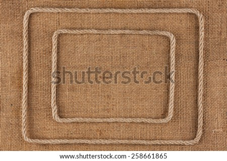 Two frame of rope, lies on a background of burlap, with place for your text - stock photo