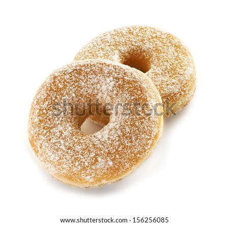 two freash and delicious tasting sugar donuts on a white background sprinkled with some sweet powdred sugar - stock photo