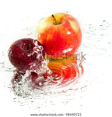two fresh apples in water splash - stock photo