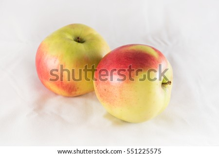 Two fresh apples on a white background