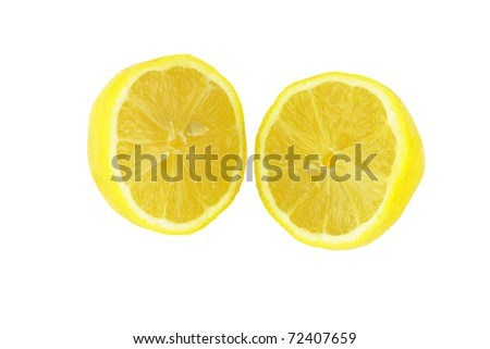 Two fresh, bright yellow citrus fruit pieces on white.
