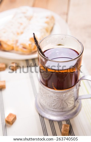 two fresh desserts on a dish with tea and sugar - stock photo