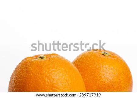 Two fresh grapefruit(orange) close up isolated white at the studio. - stock photo