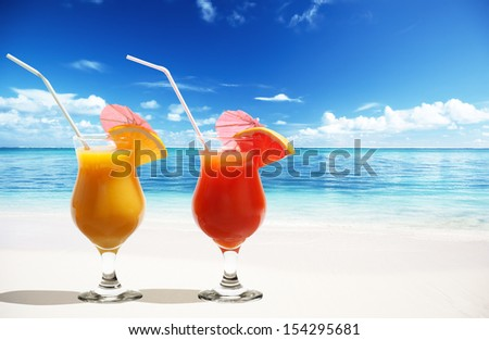 Two fresh juices on beach  - stock photo