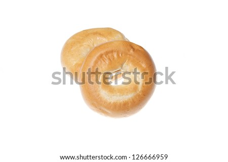 Two fresh plain bagels isolated on a white background - stock photo