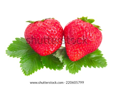 two fresh red strawberries with green  leaves  isolated on white background - stock photo