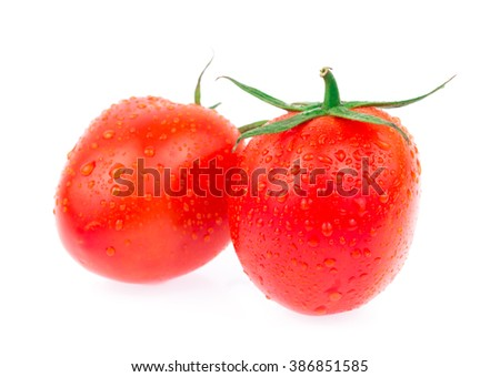 Two fresh red tomatoes isolated on white background - stock photo