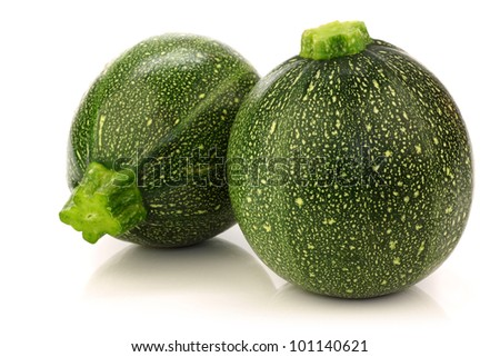 two fresh Round Zucchini's on a white background - stock photo