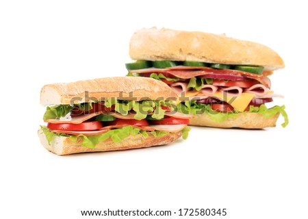 two fresh sandwiches isolated on white background - stock photo