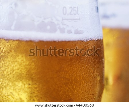 Two fresh served draft  beer in glasses with selective focus