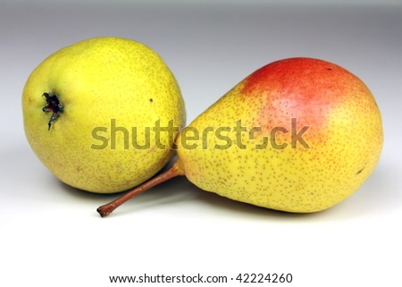 Two fresh yellow pears