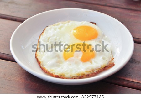 Two fried egg on dish - stock photo