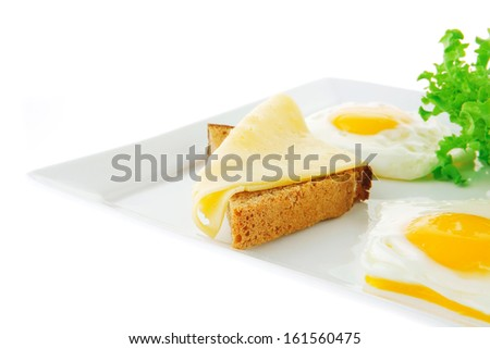 two fried eggs with salad bread and cheese - stock photo