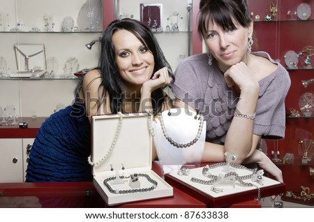 Two friendly woman sellers - stock photo