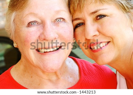 Two friendly women smiling and having a good time together.