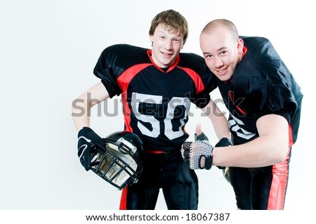 Two friendly young American football players - stock photo