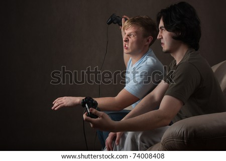 two friends are disappointed with video game - stock photo