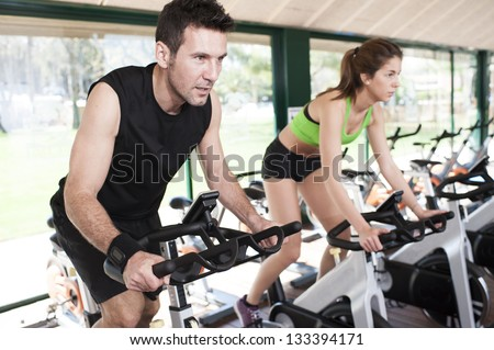 two Friends Are In A Spinning Class At Gym - stock photo
