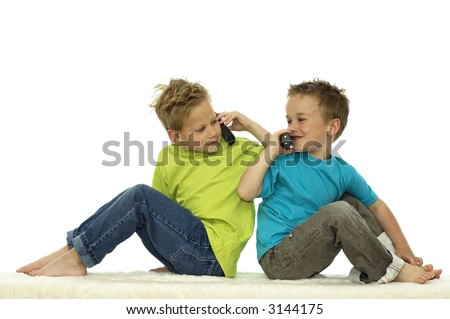 Two friends calling each other  while sitting with their backs against each other. - stock photo
