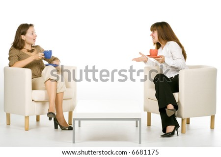 Two friends chatting with tea, isolated on white - stock photo