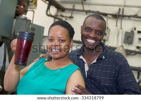 Two friends during a  coffee break at the factory - stock photo