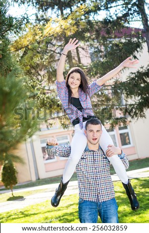 Two friends enjoying in summer day. Teenagers in park having fun. - stock photo